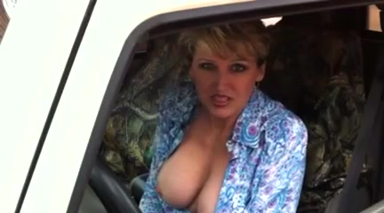 Milf sucking on her huge tits